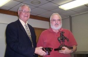 Joe Crosby Presents OKPEX Grand Award Statue To Don Hines.